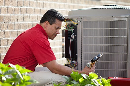 ac contractor performing maintenance on ac unit