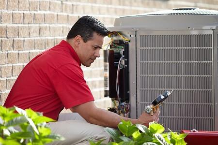 ac contractor performing repair on ac unit