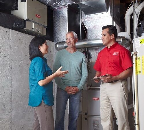 boelcke contractor discussing heating options with Baroda family